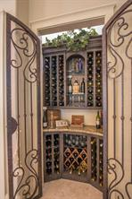 Also in the formal living room you will find a 100 bottle wine grotto with wrought iron doors. The wood work throughout the home is knotty alder.
