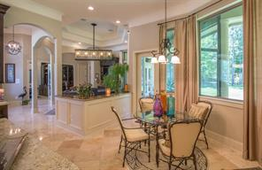 As you progress through the home past the living room, you will enter the breakfast room with its wall of windows. What a lovely spot for a morning cup of coffee.  Look how open this floor plan is.  You can see all the way back through to the entry.