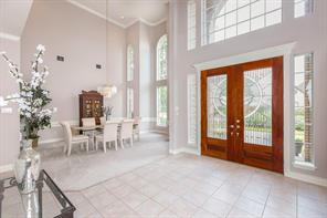 Lovely front entrance with formal dining room.