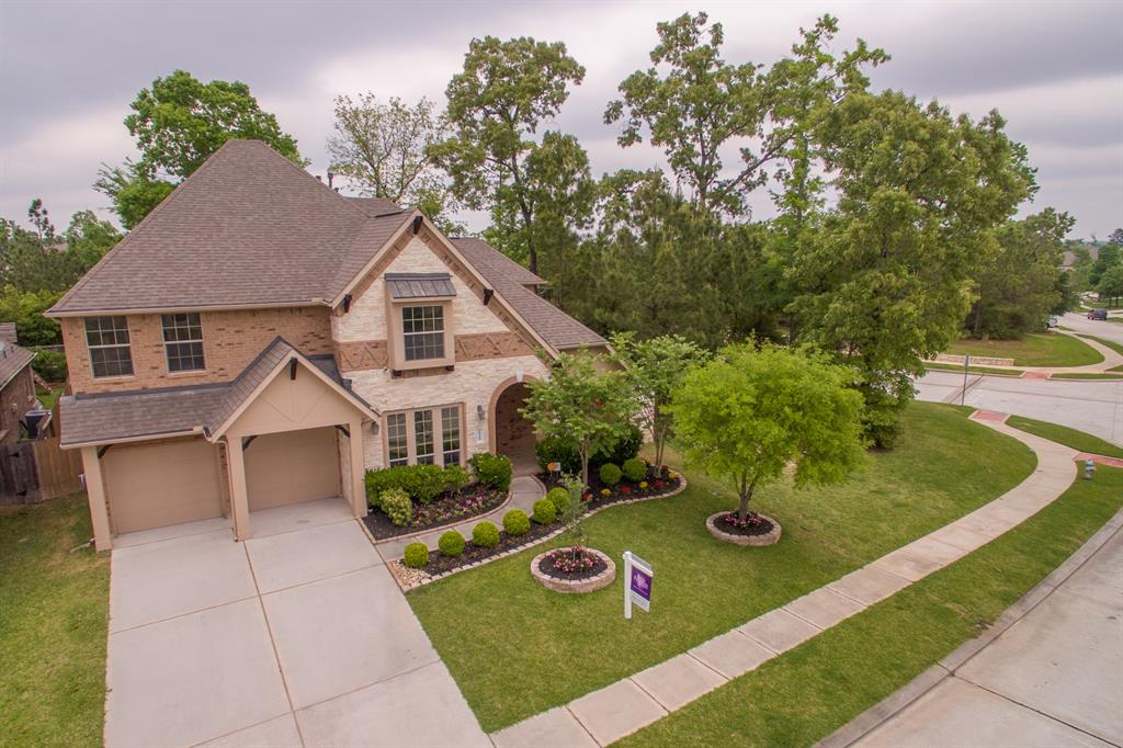 """Enjoy the outdoors w 3 outdoor living spaces!  Entertain in the gameroom with pool table & 3 tvs, opening out to 16 x 15 balcony.  4 bdrms, 3.5 baths, Study, Media rm, & Gameroom w French doors leading to balcony w cedar planked ceiling & mounted TV. The entire 1st floor has wide plank hardwoods, inc master suite. Vaulted ceiling in fam room accented by fireplace w hearth & floor to ceiling stone enhancement.  Upgrades inc kit cabinetry w upper & lower lighting, crown moldings, highend custom granite, fridge cabinet wrap, dbl ss ovens, custom lighting plus cans, Family rm has 5.1 SS and 55"""" TV, Media room has 7.1 SS w 110"""" screen, Gameroom has dry bar & fridge & 3 mounted TVs plus pool table and ALL STAY.  Speakers in fam rm, dining rm, gameroom, balcony & patio.  Patio w TV, extended patio & walkway from back to front porch in slate . Home has Vivint SMARTHOME system for additional security. All this plus Woodlands Schools, 2.2 miles to IH45 for access & the JONES STATE FOREST!"""
