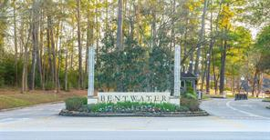 Beautifully wooded lot at 193 Bent Tree in the gated Bentwater Country Club community.