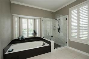 A shower for two and a spa-like garden whirlpool tub.