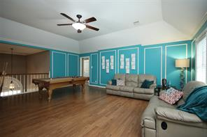 Large gameroom upstairs with vaulted ceiling.