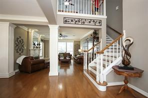 Elegant entry, open and airy with rich hardwood floors.
