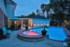 Pool has a spa tub and waterfall. Pool is heated.