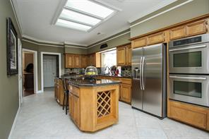 A chef's delight!  Kitchen offers gorgeous granite counters, double stainless steel ovens, mosaic backsplash and flat cooktop.