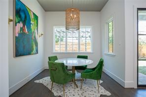 Breakfast room: Random width wide plank white oak floors, 11' tongue and groove ceiling, brass wire light fixture, views to rear garden