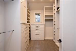 Master Closet: Dual closets with extensive hanging space and built-in chests of drawers, valet rods, full length mirror and jewelry storage