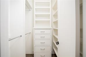Bed 4: Walk-in closet with built-in chest of drawers.