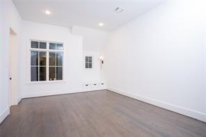 Gameroom: Random width wide plank white oak floors, recessed lighting, 11' ceiling, window bench with drawer storage, game and A/V closet, views to front garden and Live Oaks, could be bedroom #5