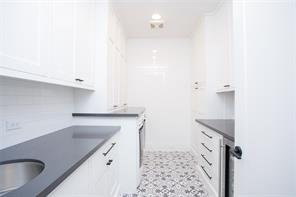 Utility: Retro 20's style floor, recessed lighting, 9' ceiling, concrete quartz counter, white subway tile backsplash and walls, matt black hardware, stainless steel sink with contemporary chrome faucet, hobby counter with mini-fridge, abundant storage, gift wrapping drawer, Maytag Commercial Technology washer and dryer