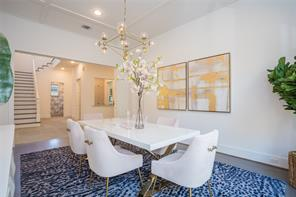 Dining: Random width wide plank white oak floors, brass and glass chandelier, recessed lighting, 11' ceiling with decorative beams, wired for sound