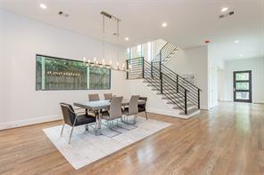 Powder Bath: Select white oak floors, LED recessed lighting, custom cabinets with Caesarstone counter, white vessel sink, chrome wall mounted faucet, Porcelanosa tile backsplash