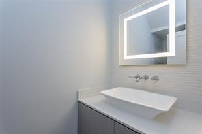 Kitchen: Select white oak floors, LED recessed lighting, chrome hardware, custom cabinets with soft close