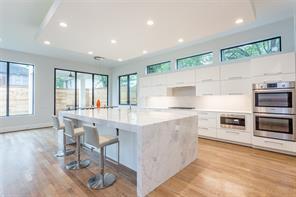 Kitchen: Caesarstone counters, Porcelanosa backsplash, stainless steel Sub-Zero refrigerator, Wolf 5 burner gas cooktop, double Bosch electric ovens, Wolf microwave drawer, Bosch Dishwasher
