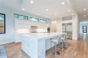 Breakfast: Select white oak floors, chrome multi-pendant chandelier, LED recessed lighting, sliding doors to covered patio