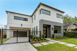 Entry: Painted mahogany 3-light front door, select white oak floors, LED recessed lighting, views to landscaped motor court.
