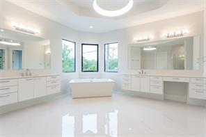 Master Bath: Large Porcelanosa shower with marble tile floor, Moen chrome shower head, rain head and hand spray