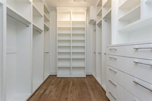 Bed 2 (middle-east): Select white oak floors, sleek 3-blade fan, LED recessed lighting, chrome hardware, storage closet, built-in desk with cabinets and drawers