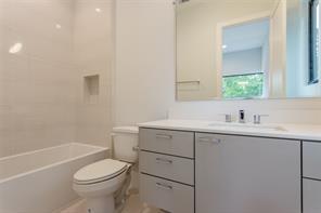 Bed 3 (middle-west near gameroom): Select white oak floors, sleek 3-blade fan, LED recessed lighting, chrome hardware, walk-in closet