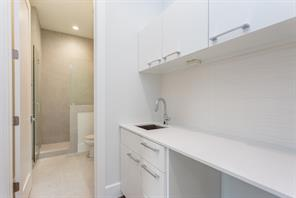 Utility: Porcelanosa tile floors, LED lighting, chrome hardware, Caeserstone counter, stainless steel deep sink with chrome faucet/sprayer, abundant storage, gas and electric connections