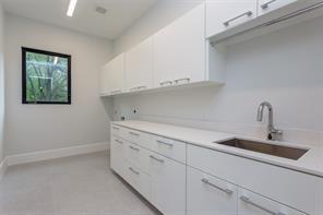 Bed 4 (front): Select white oak floors, sleek 3-blade fan, LED recessed lighting, chrome hardware, walk-in closet