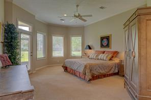 Large master bedroom at the back of the home also has nice views of the golf course, plus a door that leads to the covered screened in patio.
