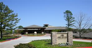 April Sound club house; April Sound has 27 holes of golf, tennis center, fitness center, swimming pools, boat launch area, and two parks for residents to enjoy.