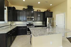 The large, granite covered island would make a great breakfast bar with the addition of a few barstools.