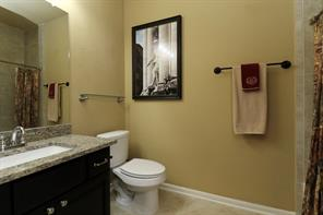 The second full bath is large and features a granite topped sink and a tub/shower combination.