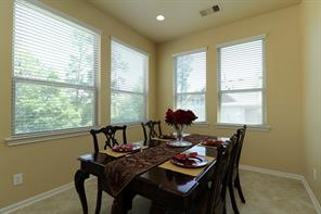 The dining room is conveniently located near the kitchen and will comfortably seat eight for dinner!