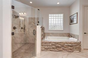 MASTER SPA BATH With a large walk-in frameless shower, deep soaking tub. All the space & luxury appointments to make getting ready together convenient. The closet is a great size.