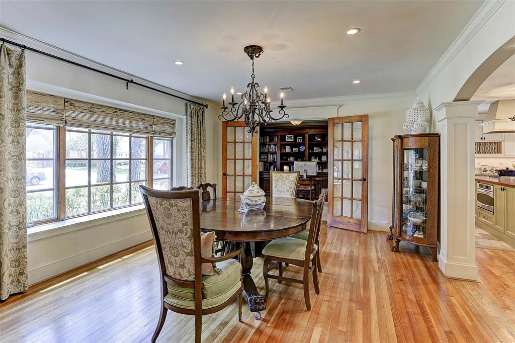 Large Windows With Wood Grid Overlook The Manicured Front Lawn French Doors Open To Handsome Study Library Elegant Formal Dining Room