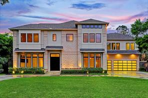 This gorgeous contemporary/modern home in Bellaire sits on a large lot (20,475 sq. ft. per HCAD).   This home features 6 bedrooms and 7. 5 baths with 8,409 square feet of living space (per HCAD).   The home has never flooded.