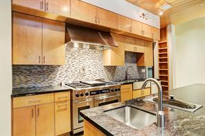 The chef's kitchen is truly amazing.   It has a large amount of storage, granite counters, stainless Dacor range with 6 gas burner, two ovens and stainless hood.   There is also a pot filler, steamer  and vegetable sink in the huge island.