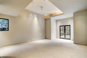 Large Master Bedroom with French Doors to back yard/pool area.   High 14' ceilings, custom lighting, recent carpet and a private sanctuary on the first floor.