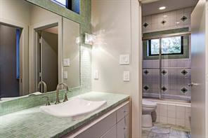 Wonderful bath with separate sink area and shower/tub combination.