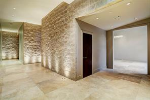 This entry way is truly phenomenal with travertine floors, custom lighting and split face CMU walls.   Stunning walls just the way they are or to hang beautiful art from.    Plenty of entry way storage also.