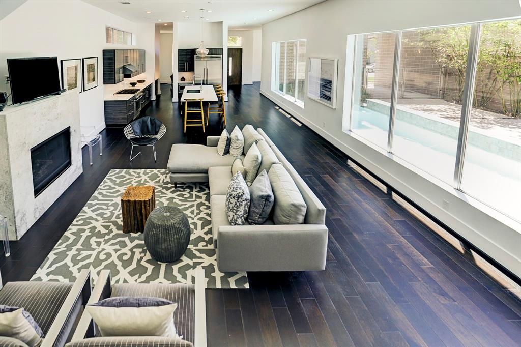Modern marvel in the heart of Montrose featuring a private pool & large, open, light filled living spaces. Magnificent island kitchen with Thermador appliances combines with formal living room with gaslog fireplace to create one huge space with superb view out to pool area via substantial windows. High ceilings, dark hardwood floors, sleek quartz counters & gorgeous modern light fixtures throughout this stunning home. Exceptionally central Houston location walkable to H-E-B, the Menil, Rothko Chapel, Cherryhurst Park & all the acclaimed restaurants, bars & cafes along Westheimer (Hugo's, Anvil, Agora, etc.). Schedule your appointment today!