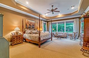 When you walk into the master suite, you'll find the spacious room with plenty of room for a sitting area. The windows look over the pool and yard.