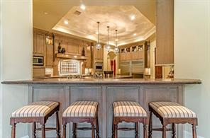 On the opposite side of the main sink is the breakfast bar. Plenty of room to hang out and visit with the chef!