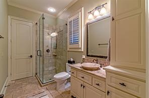 Just behind the family room is this bathroom, which serves as the pool bath and guest bedroom bath.