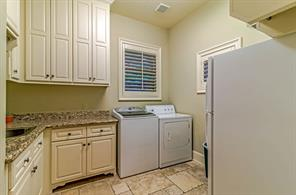 Just off the garage entry is this huge laundry room.
