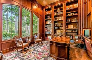 Just to the left of the front door is your paneled study.