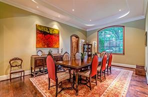To the right of the entry is the formal dining room. Notice the custom hardwood floors, and in the back of this photo you get a glimpse of the wine cellar.