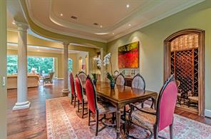 Another great view of the dining room and open floor plan leading to the living room and pool.