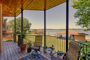 Welcome to 191 Lake View Circle, take in the stunning views of Lake Conroe from the back porch.