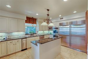 Gourmet kitchen with sub zero fridge, loads of storage, granite counters, double ovens with convection capability.  A chef's dream and entertainers delight!
