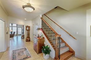 Stairs lead to sitting room, study, master suite and three guests room.