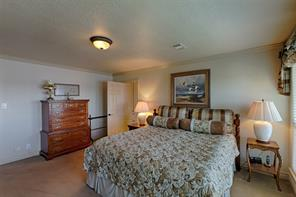 Master suite features crown molding and gorgeous views of Lake Conroe.